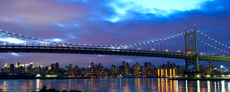 high rise: New York City Manhattan skyline panorama with Triborough Bridge over East River at sunset