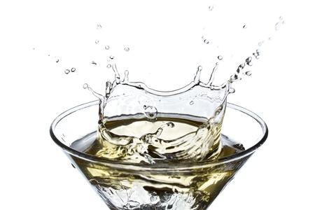 martini splash: Splashing Martini isolated on white background Stock Photo