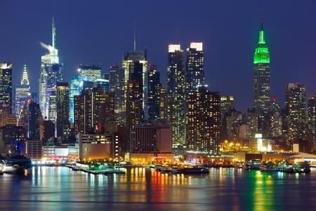 new york city skyline: New York City midtown skyline at night over Hudson river Stock Photo
