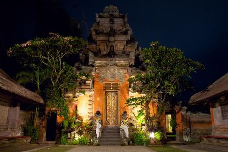 puri: Balinese temple Royal Palace at night, Ubud, Indonesia Stock Photo