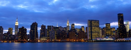 urban jungle: New York City Manhattan midtown skyline over East River at dusk