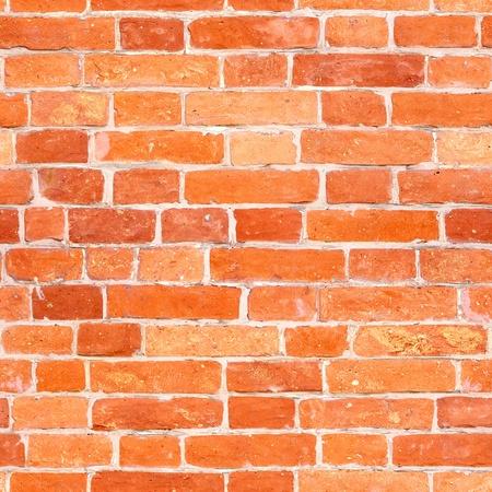 Seamless red brick wall texture photo