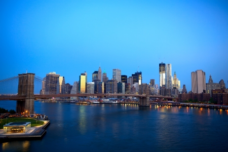Sunrise view of Brooklyn Bridge and Lower Manhattan skyline in New York City photo
