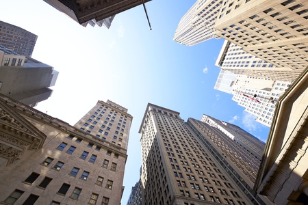 new york stock exchange: Highrise buildings at the Wall Street financial district in New York City, USA