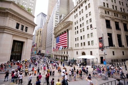 stock: New York, New York, USA - July 4, 2012: The intersection of Wall Street and Broad Street including landmark buildings of the New York Stock Exchange on Independence Day Editorial