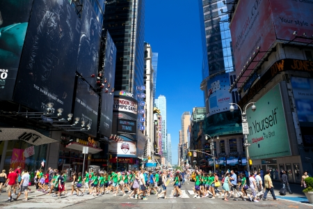 New York, New York, USA - July 6, 2012: Busy intersection at 42nd St. and Broadway near Times Square with pedestrian