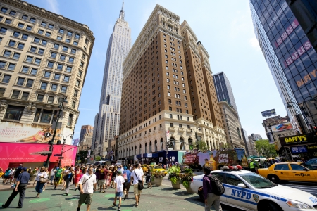 New York, New York, USA - July 7, 2012: Herald Square with busy traffic, yellow taxi and crowds of people in Midtown Manhattan