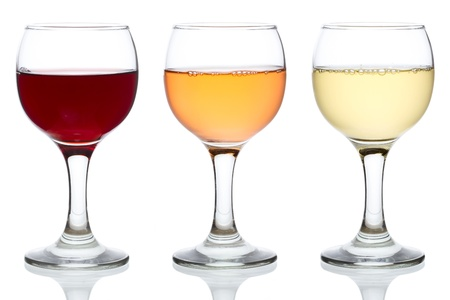 white wine glass: Three glasses of red, rose and white wine isolated on white