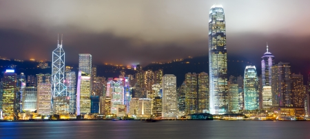 Hong Kong skyline at mist over Victoria harbor photo