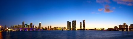 Panoramic view of Miami skyline and Biscayne Bay at dusk photo