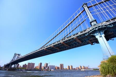 Manhattan Bridge over East River with skyline, New York City photo