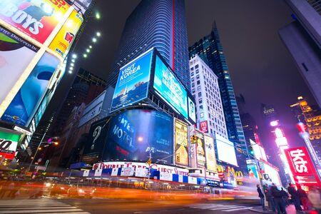 square: New York, New York, USA - January 13, 2013: Busy traffic in Times Square with lots of illuminated billboards at night