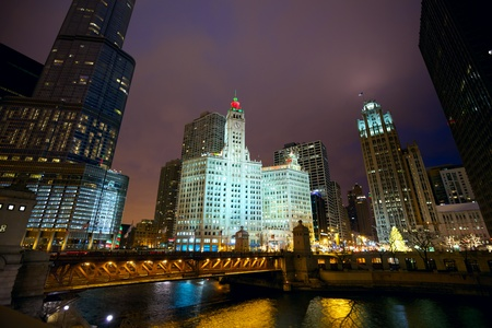 Chicago River skyline and Michigan Avenue Bridge at night, IL, USA photo