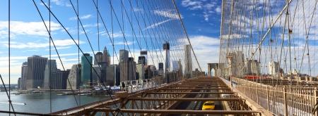 Panoramic view of Manhattan skyline from Brooklyn Bridge, New York City Stock Photo