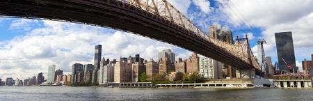 Manhattan skyline panorama with Queensboro Bridge over East River, New York photo