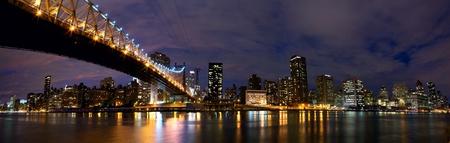 queensboro bridge: NYC Queensboro Bridge and Manhattan skyline panorama at night