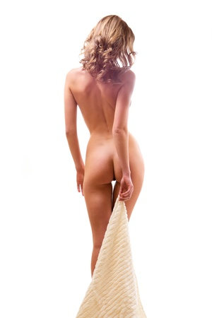 woman nude standing: Young nude woman with towel from behind on white