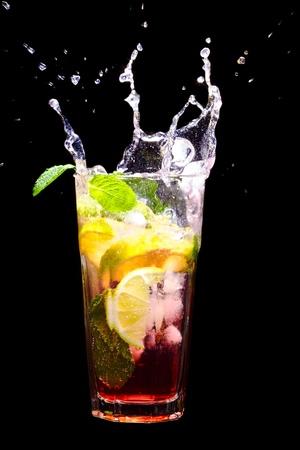 splash mixed: Mojito Cocktail with splash on black