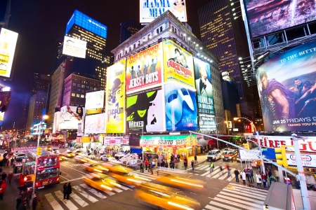 New York, New York, USA - January 17, 2013: Crossroad in Times Square with traffic, lots of illuminated billboards at night Editorial