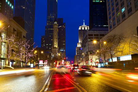 Michigan Avenue and Magnificent Mile with traffic at night, Chicago, IL, USA photo