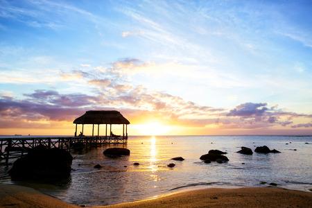 mauritius: Jetty silhouette against sunset in Mauritius Stock Photo
