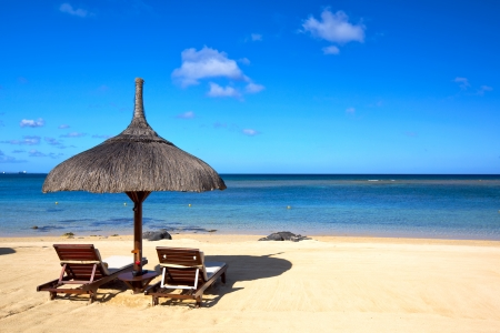 mauritius: Tropical beach with chairs and umbrella in Mauritius