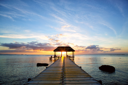 pontoon: Jetty silhouette against beautiful sunset in Mauritius Island