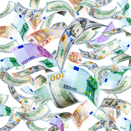 Dollar and Euro banknotes falling and spinning isolated on white photo
