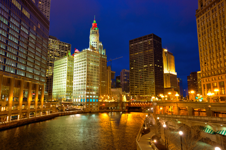 Chicago River Walk with street lights and water reflections at dusk, IL, USA photo
