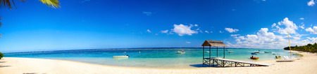 mauritius: Panoramic view of tropical beach with jetty and boats