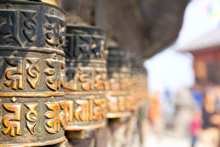 sanskrit: Prayer wheels at Swayambhunath temple in Kathmandu, Nepal