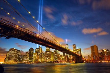september 11: Lower Manhattan skyline with Brooklyn Bridge and the Towers of Lights (Tribute in Light) in New York City