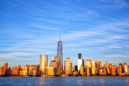 freedom tower: One World Trade Center and Lower Manhattan skyline at sunset, New York