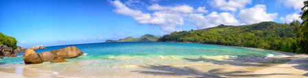 seychelles: Panoramic view of Anse Takamaka beach with typical granite rocks, Mahe, Seychelles Stock Photo