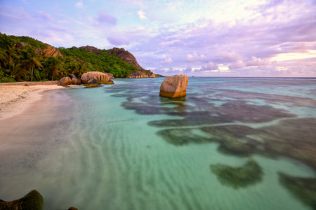 argent: Anse Source d Argent at sunset, La Digue, Seyshelles Stock Photo