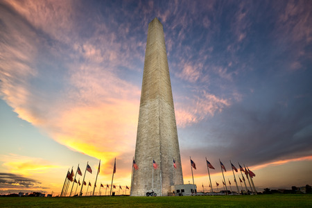 Washington Monument with american flags at sunset, Washington DC