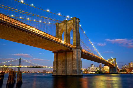 new york skyline: Brooklyn Bridge at twilight in New York City