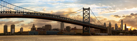 Philadelphia skyline panorama and Ben Franklin Bridge at sunset, US 写真素材