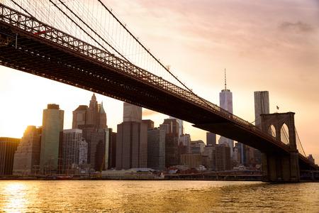 megalopolis: Manhattan skyline with Brooklyn Bridge at sunset, New York City Stock Photo