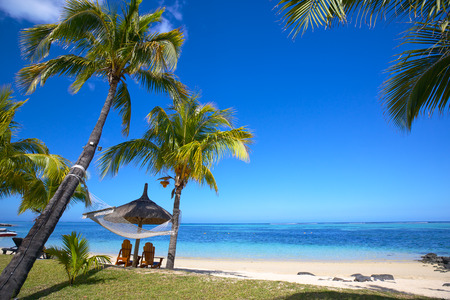 Mauritius beach with chairs and umbrellas Stock Photo