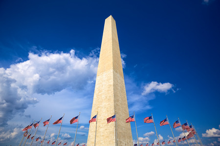 Washington Monument with american flags, Washington DC 写真素材