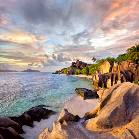 tropical paradise: Anse Source dArgent beach at sunset, La Digue Island, Seyshelles Stock Photo