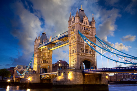 lights on: Tower Bridge at dusk, London, United Kingdom