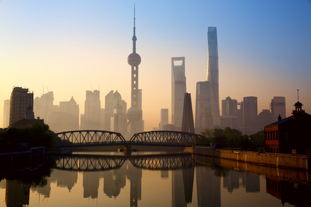 Shanghai skyline at sunrise with historical Waibaidu bridge China 写真素材