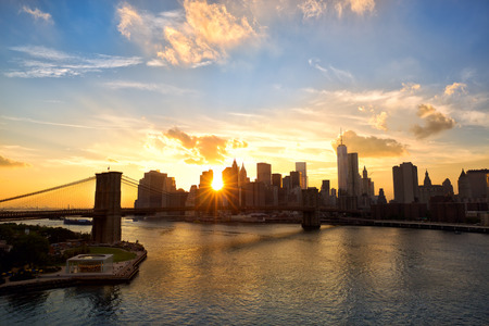 waterfront: Manhattan skyline and Brooklyn Bridge at sunset, New York
