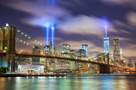 twilight: Manhattan skyline with Brooklyn Bridge and the Towers of Lights (Tribute in Light) in New York City