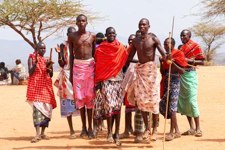 Masai Mara National Park, Kenya - September 17, 2008: Maasai men in traditional clothes dancing as cultural ceremony in village. Editorial