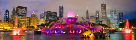 united states: Chicago skyline panorama with Buckingham fountain at night, United States Stock Photo