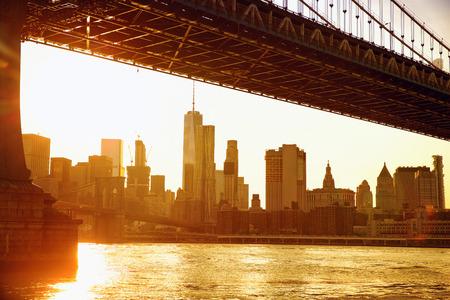 lower manhattan: Lower Manhattan skyline under Manhattan Bridge at sunset, New York