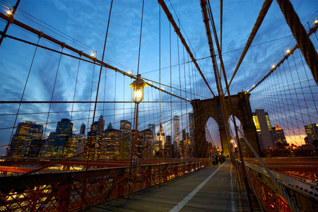 city light: Pedestrian walkway on the Brooklyn Bridge at dusk, New York